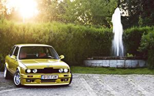 Bilder BMW Springbrunnen Gelb Autos